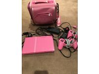 PS2 with 2 controllers & bag