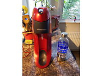 Sodastream machine with new CO2 container and one soda bottle