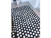 Spotty black and white rug