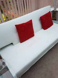 Sofabed in cream faux leather