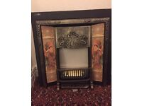 Cast iron tiled fire place and grate including gas fire fitments in excellent condition