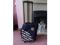 Cabin size England suitcase on wheels can also be worn as back pack