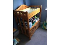 Baby wooden changing table, in good condition with storage baskets and shelf underneath