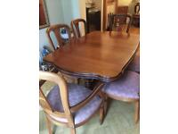 Rosemore extendable dining room table and 6 chairs