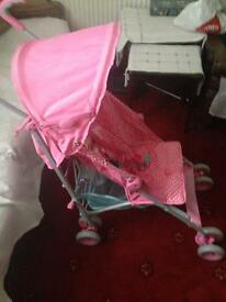 Pink push chair. Offers taken