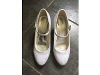 Pre-worn, white bridal shoes