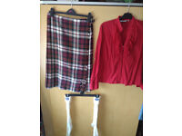 Ladies kilt, red frilly shirt and Scotland motif wollen socks