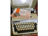 Vintage Portable Gabriele 20 typewriter with case and instructions