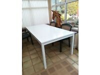 LARGE white table, powder coated aluminium..sturdy, seats 8. Inside or out.