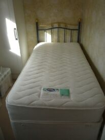 Silentnight single bed with drawers underneath and wrought iron headboard