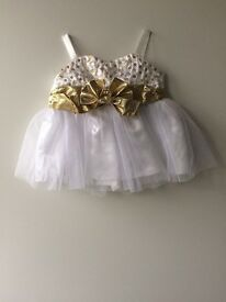 A white build a bear dress with matching sandles