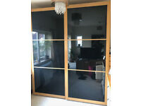 Ikea PAX Wardrobe with sliding black glass doors