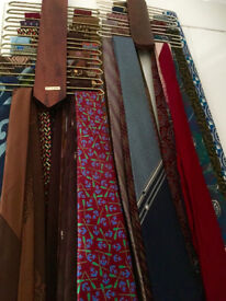 An array of 29 quality Men' ties with two wooden tie hangers