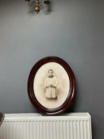 Large antique photo portrait of a choir boy & old frame