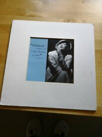 Unusual Marlene Dietrich print in black/grey/blue. 50p
