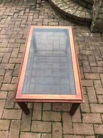Glass topped wooden table