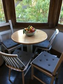 Bistro style table with 4 chairs