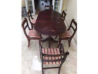 Extended Mahogany Solid Wood Dining table and 6 cushioned striped Red chairs