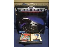 Sega megadrive boxed console and sonic games