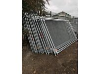 100 Heras Fence panels less than 3 months old with feet and clips.