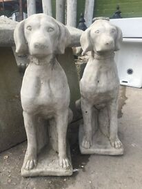 A pair of concrete dog statues