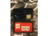 Nintendo 3DS XL with accessories and games