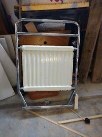 Retro type electrically heated towel rail by Myson