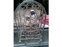 A LARGE CAST IRON WINE CAGE, VERY RUSTIC AND WITH SOME GREAT PATINA.