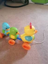 Tomy pull along ducks