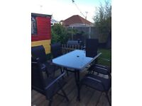 Black garden table and chairs