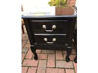 Black lacquered bedside cabinets