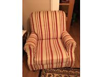 Cream and red striped manual recliner from smoke free home