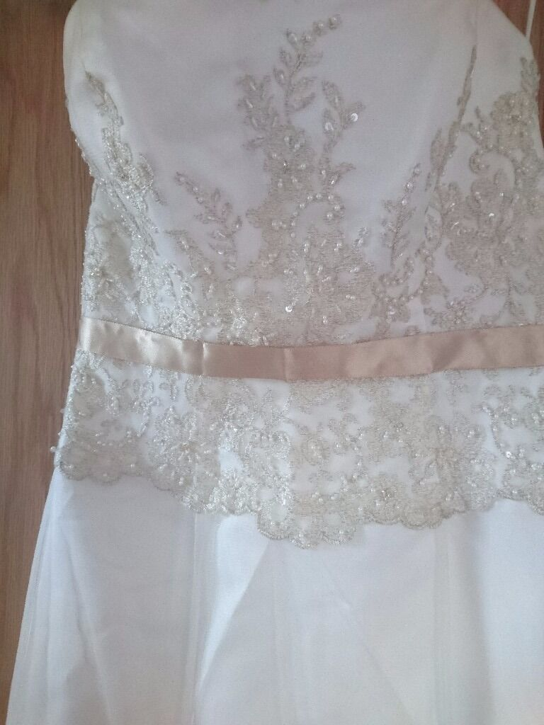 Wedding dress size 10in Newry, County DownGumtree - Wedding dress was worn once. In good condition. Size 10 M Need clean or I can do it for extra coins