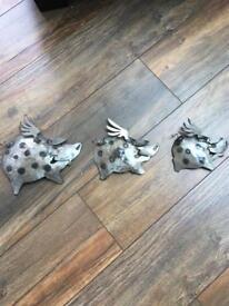 Three steel flying piggies