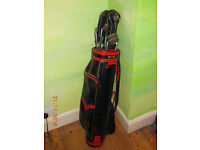 Set of golf clubs: 4 irons, sand wedge, 2 woods with covers, putter, carrying bag, 8 balls, 25 tees.