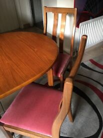 Teak, extending dining table and 4 matching chairs