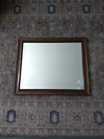 Large mirror with an elegant edging around the glass