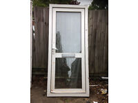 White UPVC door with obscure glazing top and bottom