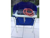 camping cooker and stand with storage under