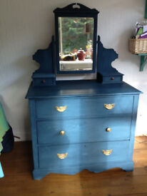 Lovely addition to any bedroom is this 3-drawer piece of furniture, chalk-painted in striking blue