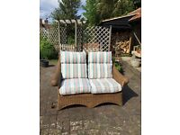 Free to a good home. Two seater sofa for garden/conservatory. Cushions need attention. 01279771028