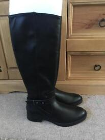 Size 7 knee high boots with tags