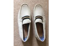 A pair of apogee white men's shoes