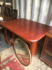 Modern extending table. Central 'butterfly ' folding leaf. Delivery possible