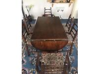 Dinning table and 6 chairs solid oak .