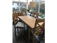 Sold wood dining table with four chairs