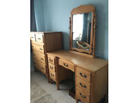 Dressing table with tilting mirror