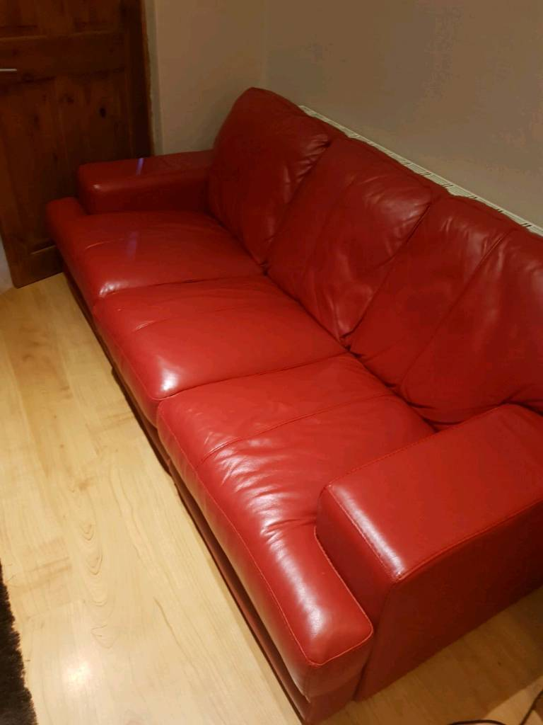 DFS RED LEATHER SOFAS