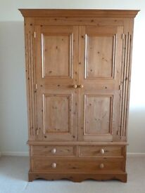 Double Pine Wardrobe With Three Drawers in Natural Wax Finish. Well cared for.
