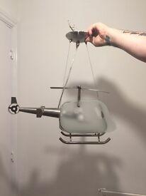A lovely modern glass helicopter light